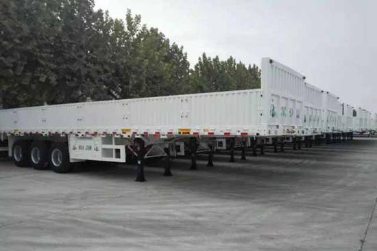 中集华骏出口东南亚30台特种集栏半挂车通过验收